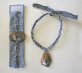 Photo on stone in jeans bracelet and madallion hanging on a jeans braid lace